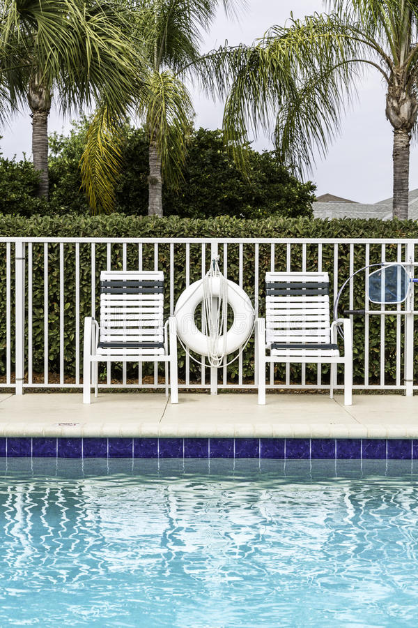 Swimming pool against palms stock photos