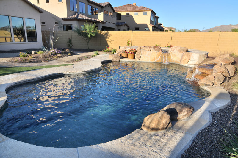 Swimming pool in back yard stock images