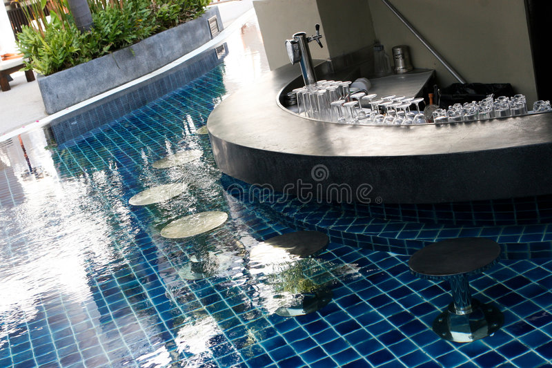 Swimming pool bar. Modern swimming pool with a built-in bar royalty free stock image