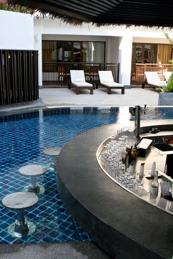 Swimming pool bar. Modern swimming pool with a built-in bar stock images