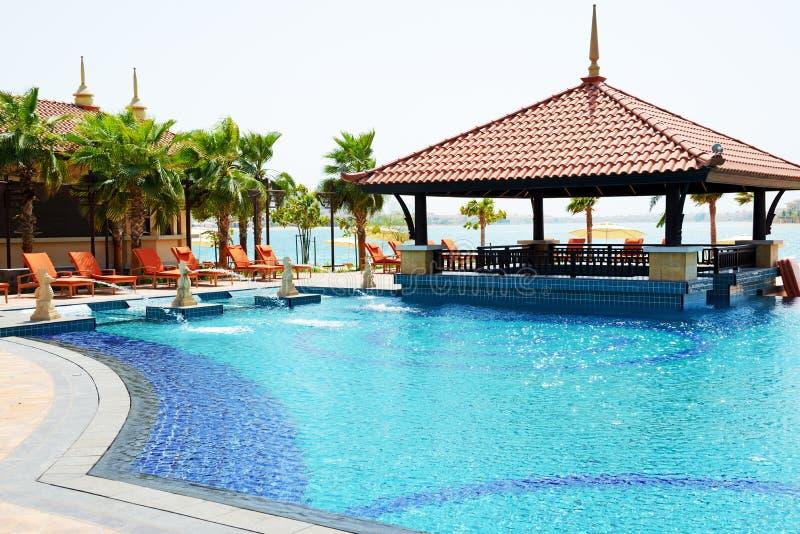 The swimming pool and bar are near beach. In Thai style hotel on Palm Jumeirah man-made island, Dubai, UAE royalty free stock photo