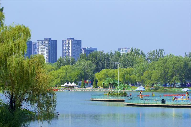 Swimming pool and beach in Chaoyang park, Beijing. Boating and views in Chaoyang park, Beijing, China stock image