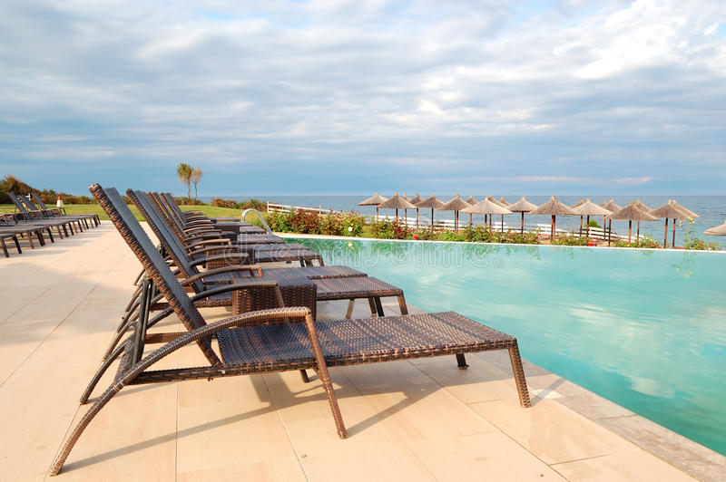 Download Swimming Pool By Beach At The Modern Luxury Hotel Stock Image - Image: 24718521