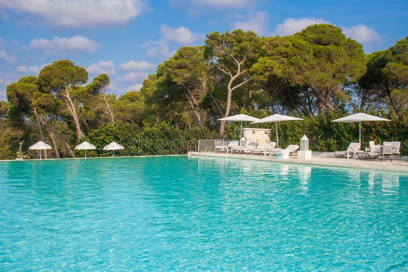Swimming pool. In beautiful luxury resort into the nature with no people, near Laghi Alimini, Lecce, Salento, Puglia, South Italy royalty free stock photo