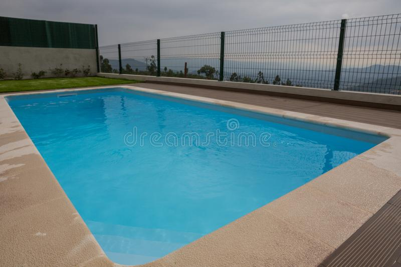 Swimming pool blue water royalty free stock photo