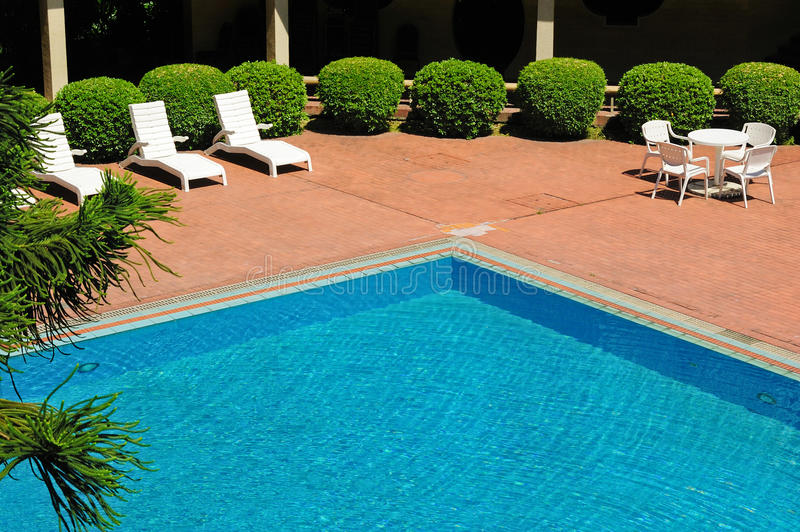 Download Swimming Pool And Chaise Longues Stock Photo - Image: 14847372