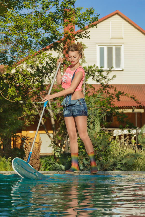 Swimming Pool Service Worker : Swimming pool cleaner at work stock image of green