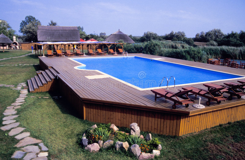 Swimming pool and deck stock image. Image of above ...