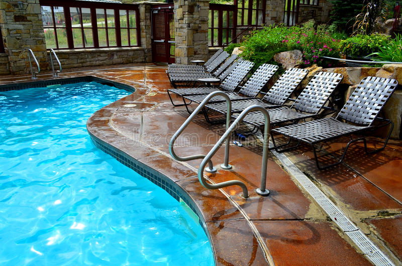 Swimming Pool Spray Deck : Swimming pool and deck chairs stock image of