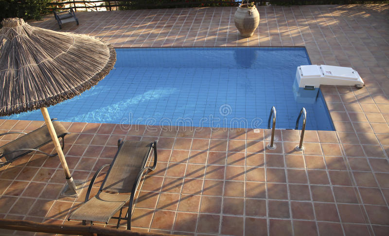 Swimming Pool With Deckchairs Royalty Free Stock Photos