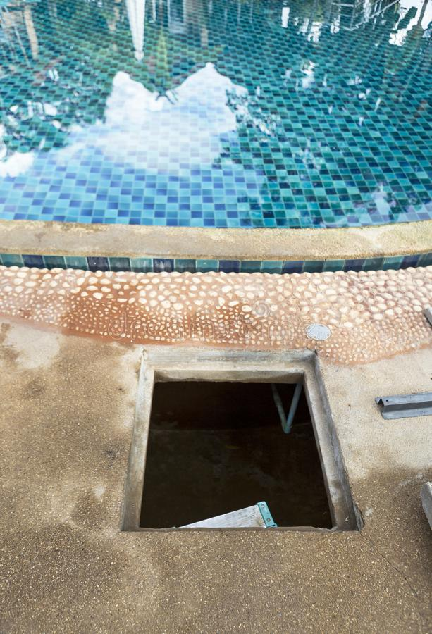 Swimming pool design and construction. Open surge tank, swimming pool maintenance royalty free stock photo