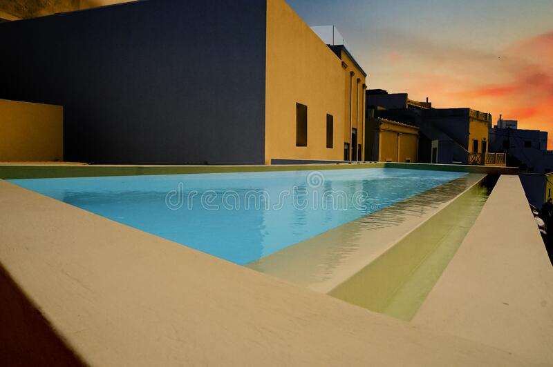 Swimming pool at dusk royalty free stock photography