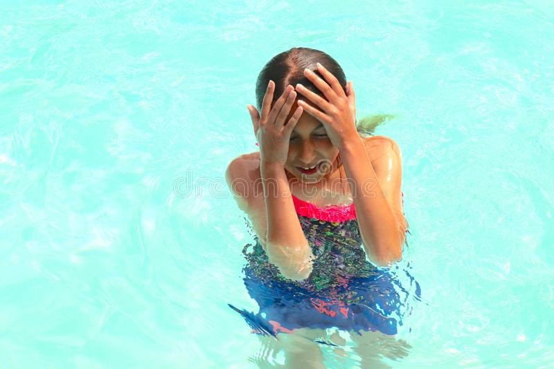 Swimming at the Pool Enjoyed by Young Girl royalty free stock image