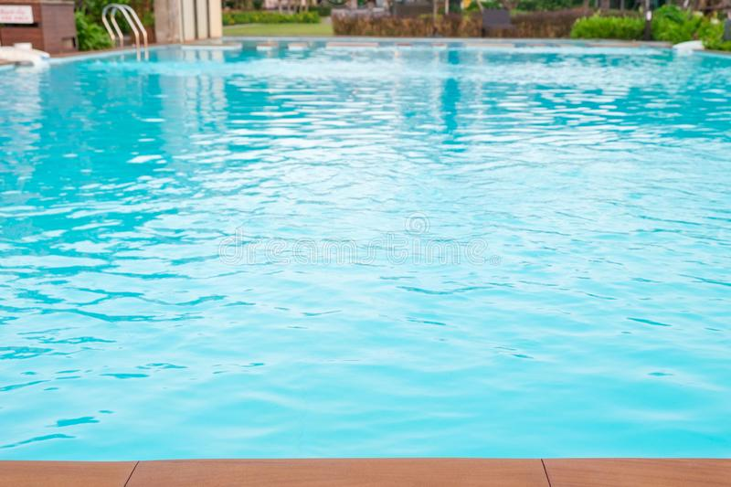 Swimming pool is in front of the hotel or resort. The swimming pool is in front of the hotel or resort royalty free stock photo