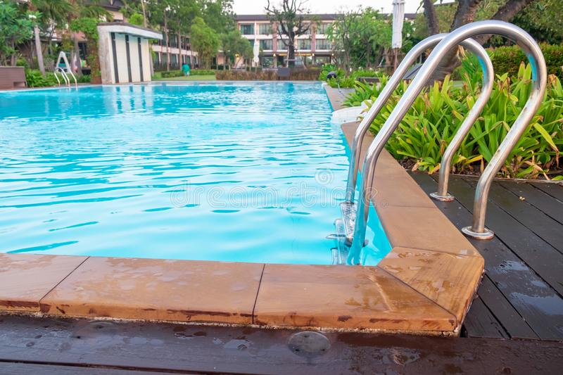 The swimming pool is in front of the hotel or resort. The swimming pool is in front of the hotel or the resort stock photos