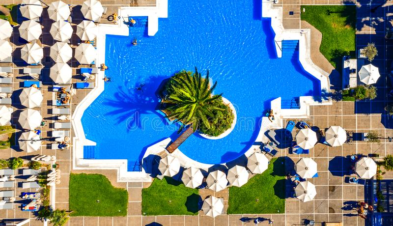 Swimming pool full of people having fun, view from above. stock photos