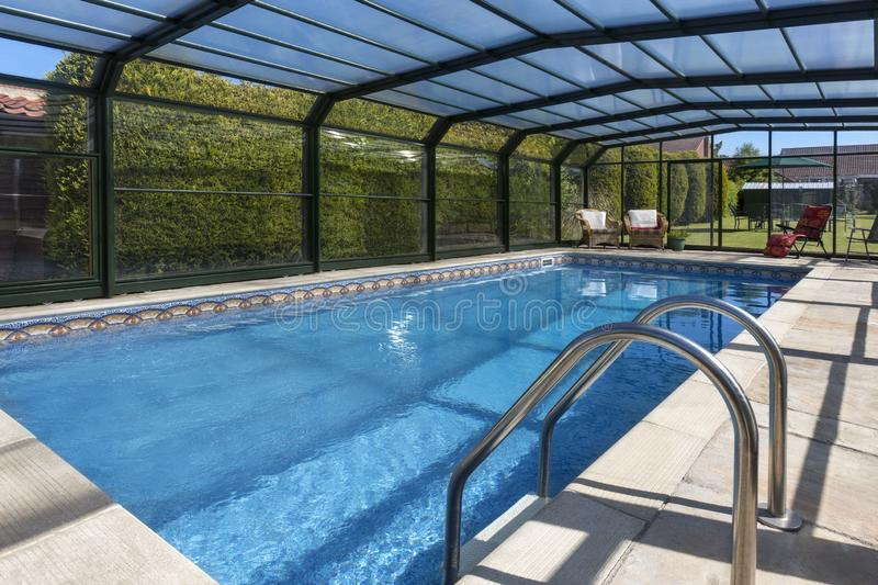 Swimming Pool in the garden of a large country property royalty free stock images