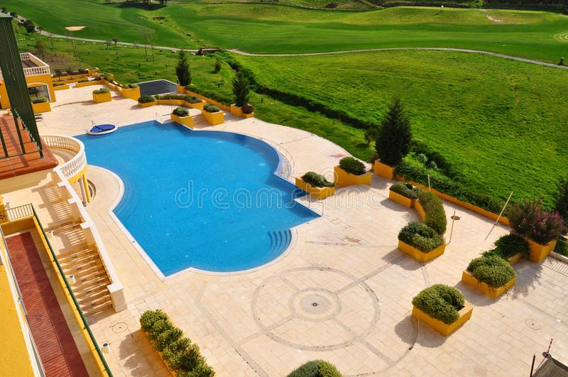 Swimming pool on golf course royalty free stock photo