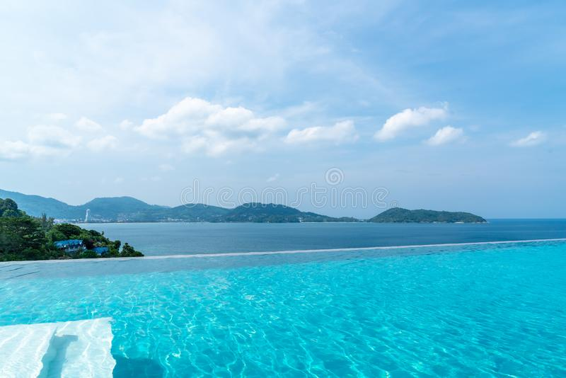 Swimming pool in hotel and resort with sky and sea. Background stock photos