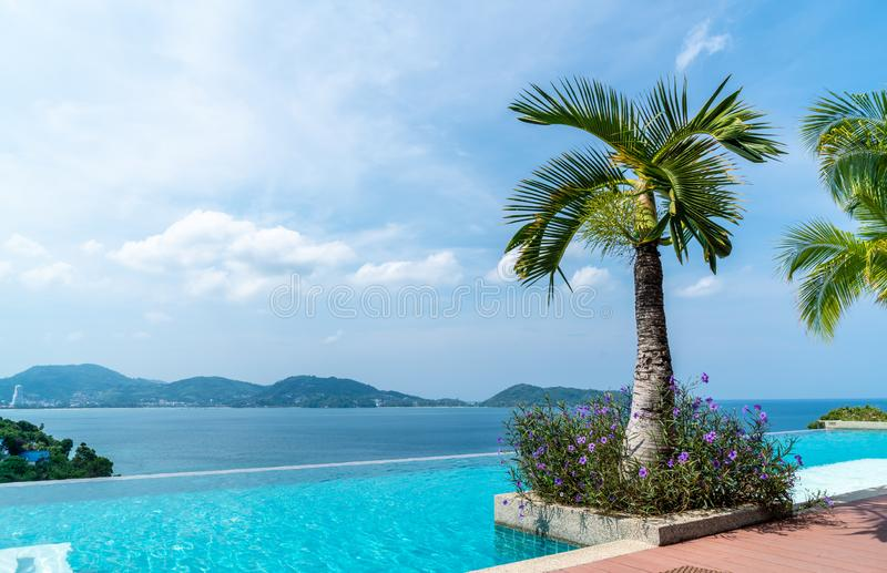 Swimming pool in hotel and resort with sky and sea. Background royalty free stock image