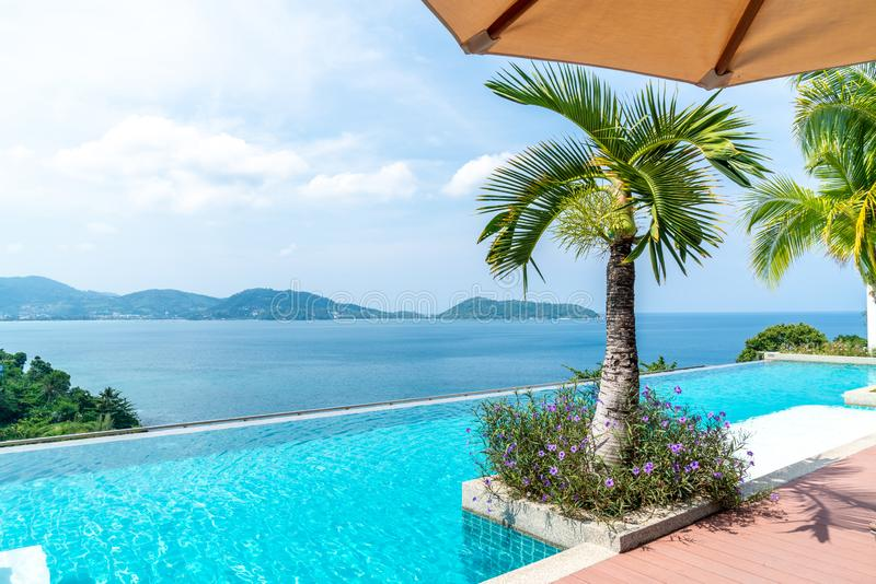 Swimming pool in hotel and resort with sky and sea. Background royalty free stock photography