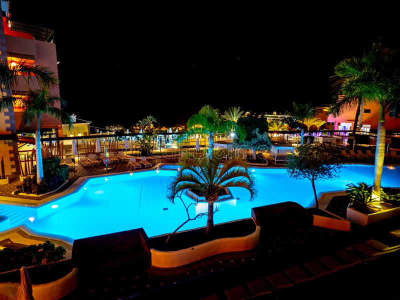 Pool of a hotel seen at night and illuminated with its own lights royalty free stock photos