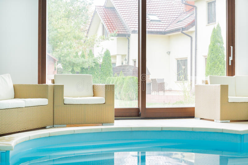 Swimming pool inside a modern residence. The large swimming pool inside a modern residence stock images