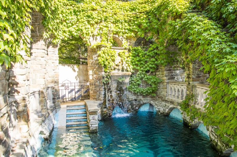 Swimming pool in Kabardinka Park with ivy covered walls stock photography
