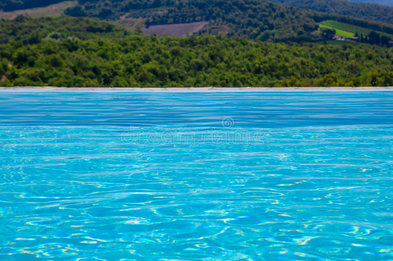 Swimming pool with landscape view royalty free stock images