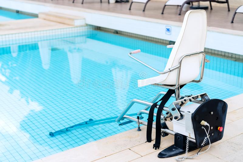 Swimming pool lifts for disabled people access to the pool. Swimming pool lifts for disabled people access to the pool stock images