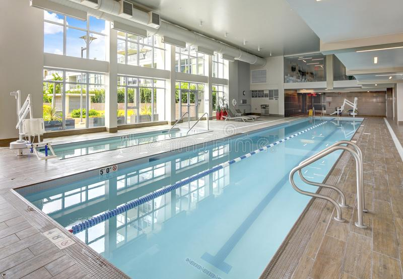 Swimming pool in luxurious apartment building. royalty free stock photography