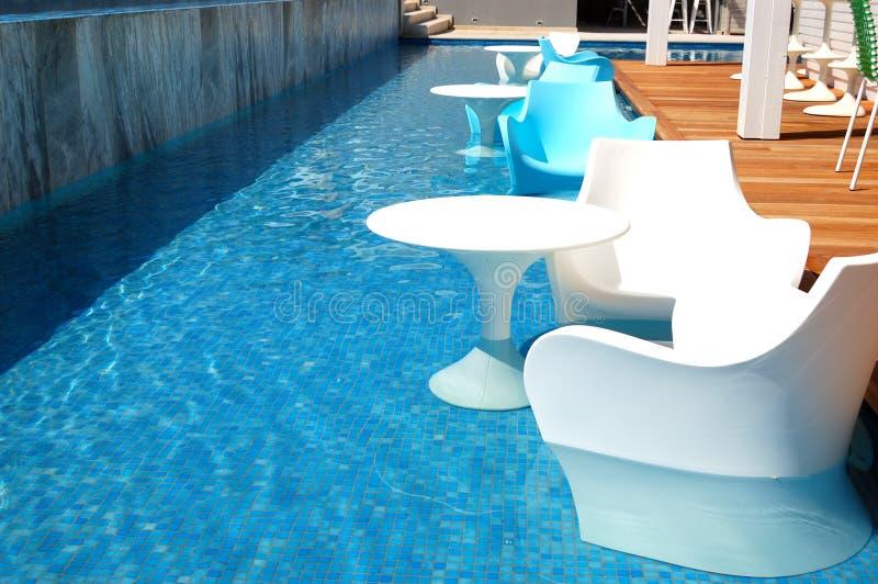 Swimming pool near bar at the modern luxury hotel stock photo