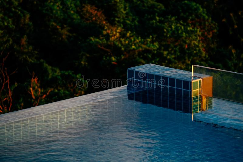Swimming pool near the trees with blurred natural background. A swimming pool near the trees with blurred natural background royalty free stock images