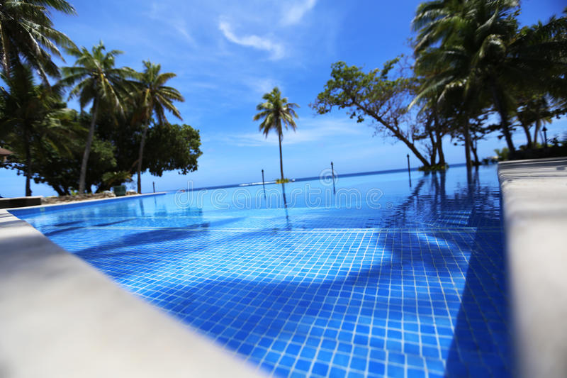 Swimming pool nearby Pacific ocean stock image