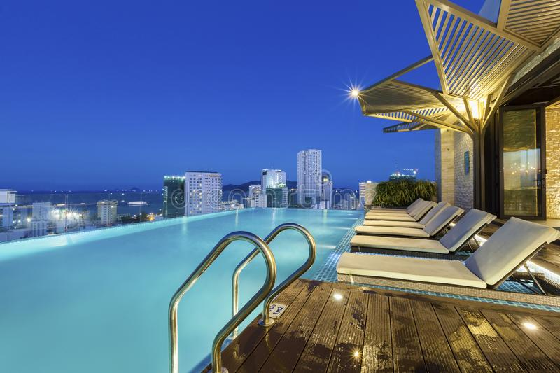 Vietnam hotel swimming pool night stock photo