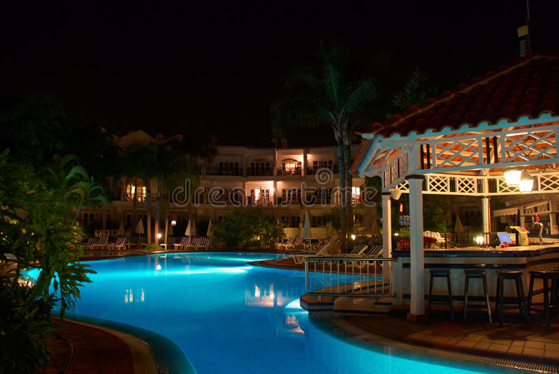 Download Swimming pool at night stock photo. Image of beach, palms - 15640454