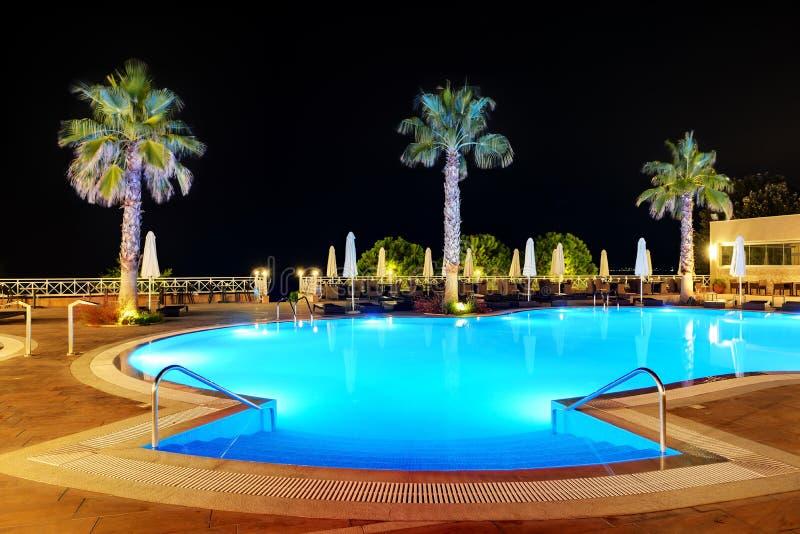 Swimming pool in night illumination. Halkidiki, Greece royalty free stock photography