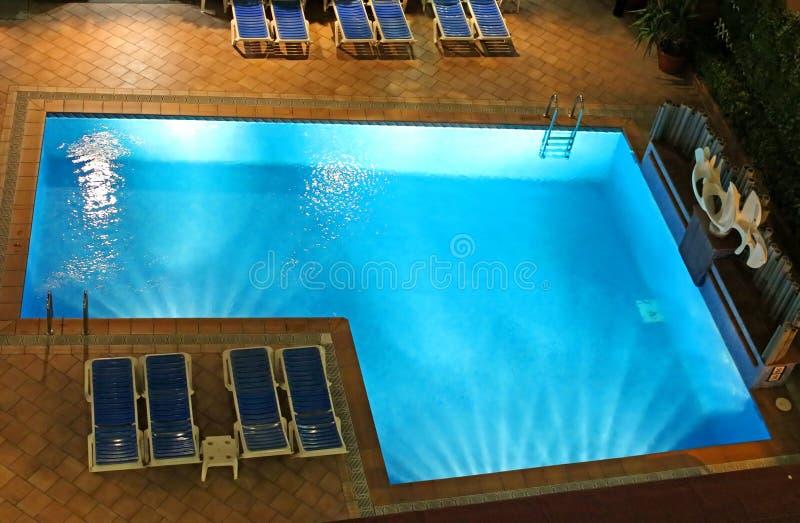 Swimming pool in night illumination stock photos
