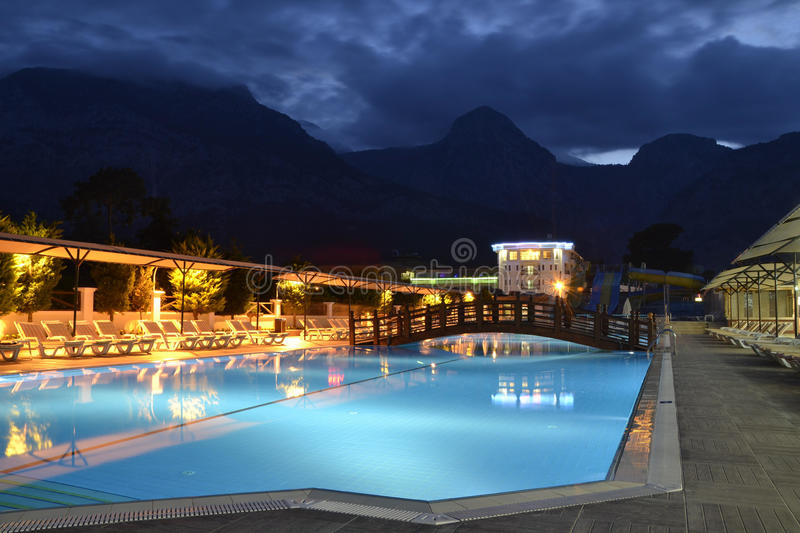 Swimming pool by night stock photos