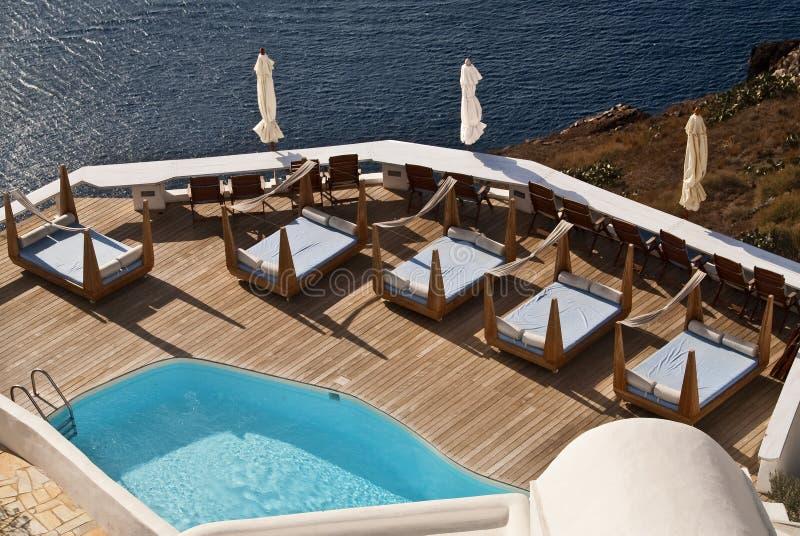 A Swimming Pool Overlooks the Santorini Caldera royalty free stock images