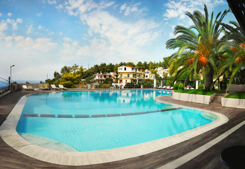 Swimming Pool Palm Garden Luxury Hotel stock photo