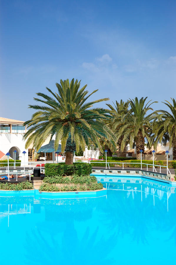 Swimming Pool And Palm Trees At The Luxury Hotel Stock Photos