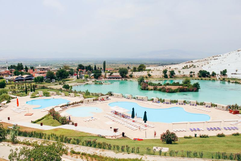 Swimming pool and Pamukkale town in Pamukkale, Turkey stock photo