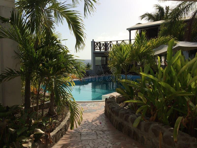 Swimming pool paradise on an island`s luxury resort royalty free stock photos