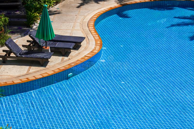 Swimming pool with Relaxing chairs stock photo