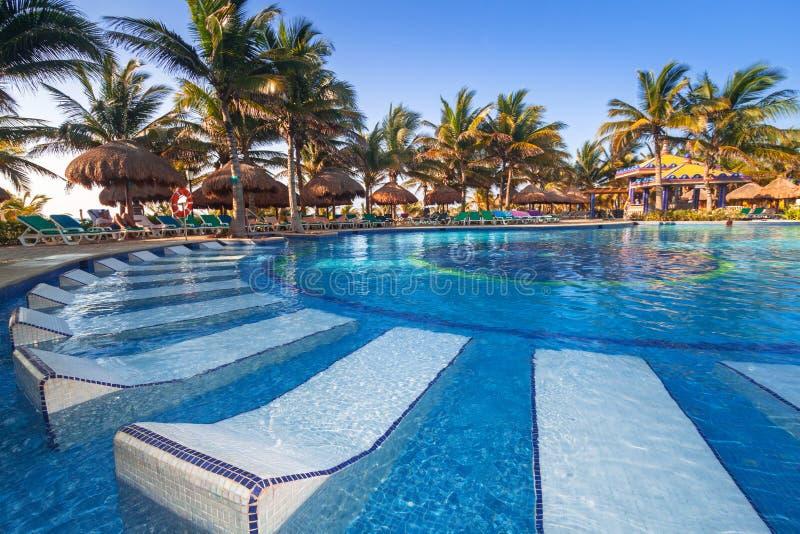 Swimming pool at the resort of RIU Yucatan Hotel. PLAYA DEL CARMEN, MEXICO - JULY 11, 2011: Swimming pool at the resort of RIU Yucatan Hotel in Playa del Carmen royalty free stock image