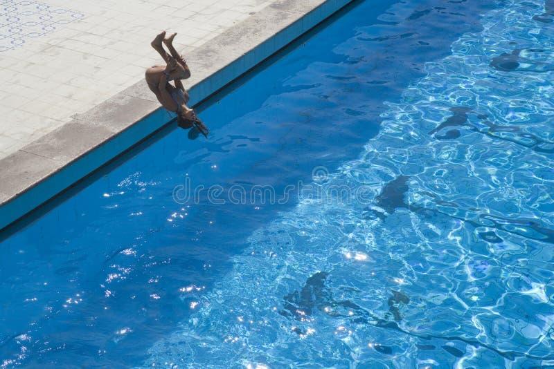 Swimming pool risky jump royalty free stock image