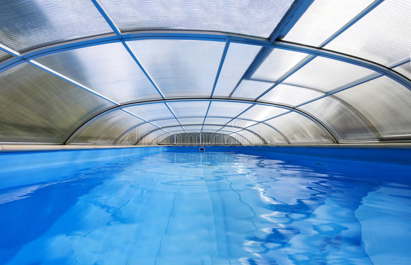 Swimming pool with roof stock photos