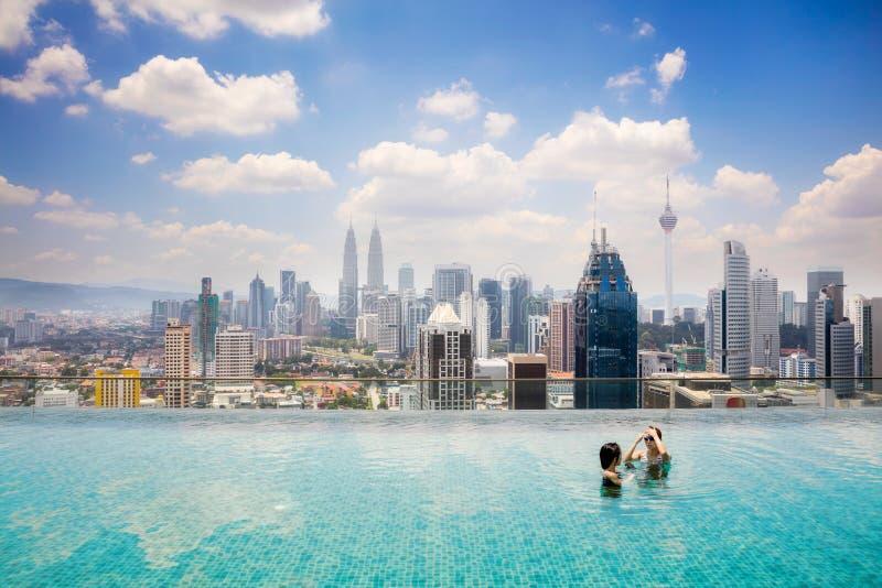 Swimming pool on roof top. With beautiful city view Kuala lumpur, Malaysia stock image