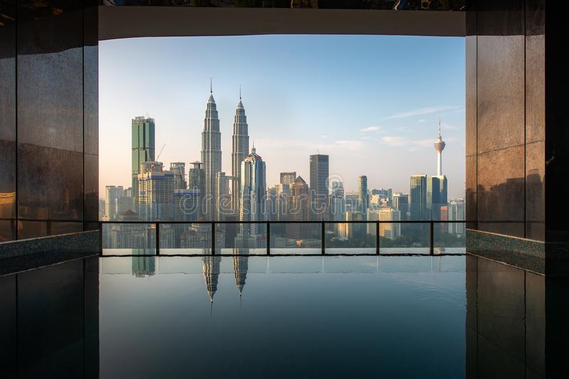 Swimming pool on roof top with beautiful city view in morning at Kuala lumpur, Malaysia. Travel and Vacation concept.  royalty free stock photo
